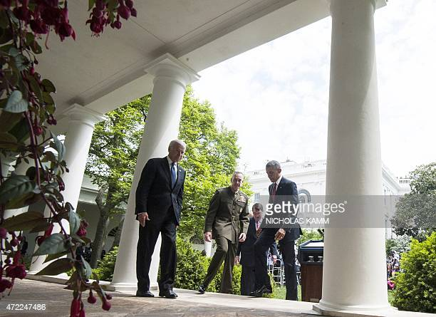 US President Barack Obama walks back to the Oval Office waves after announcing Marine Gen Joseph Dunford as his pick to be the next chairman of the...