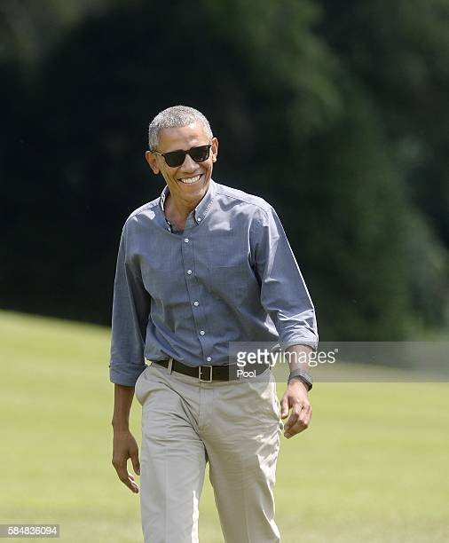 US President Barack Obama walks back to the White House after returning from Camp David on July 31 2016 in Washington DC