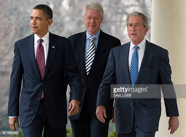 President Barack Obama walks down the West Wing Colonnade alongside former US Presidents Bill Clinton and George W. Bush before speaking about joint...