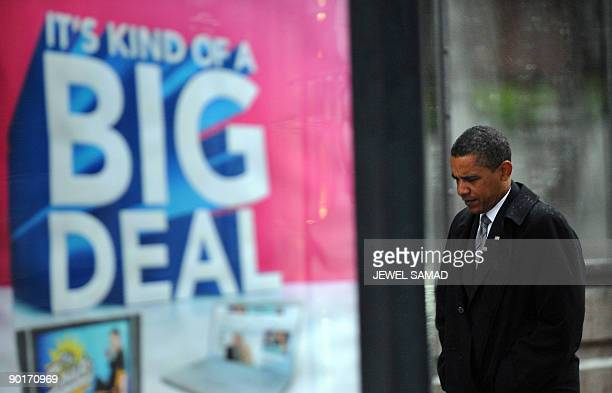 US President Barack Obama walks following a private meeting with the widow of late senator Edward Kennedy Vicki Kennedy in Boston Massachusetts on...