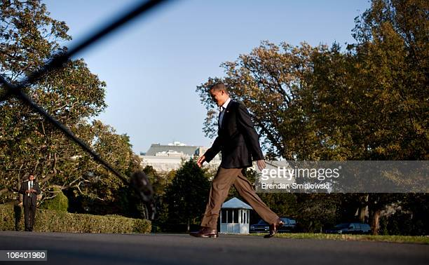 S President Barack Obama walks from Marine One on the South Lawn of the White House October 31 2010 in Washington DC President Barack Obama returned...