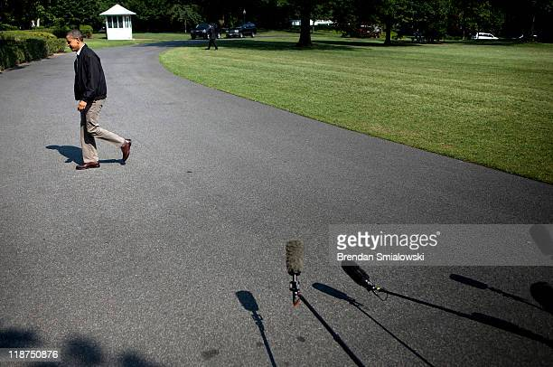 S President Barack Obama walks from Marine One to the residence of the White House July 10 2011 in Washington DC President Obama returned from Camp...