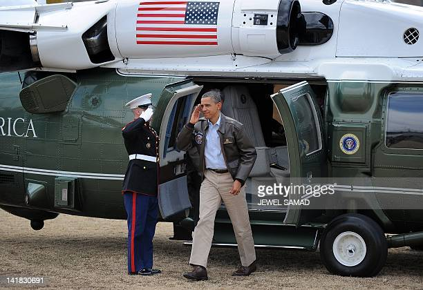 US President Barack Obama walks from Marine One upon arrival at army base Camp Bonifas in Paju during a visit to the Demilitarized Zone on the border...