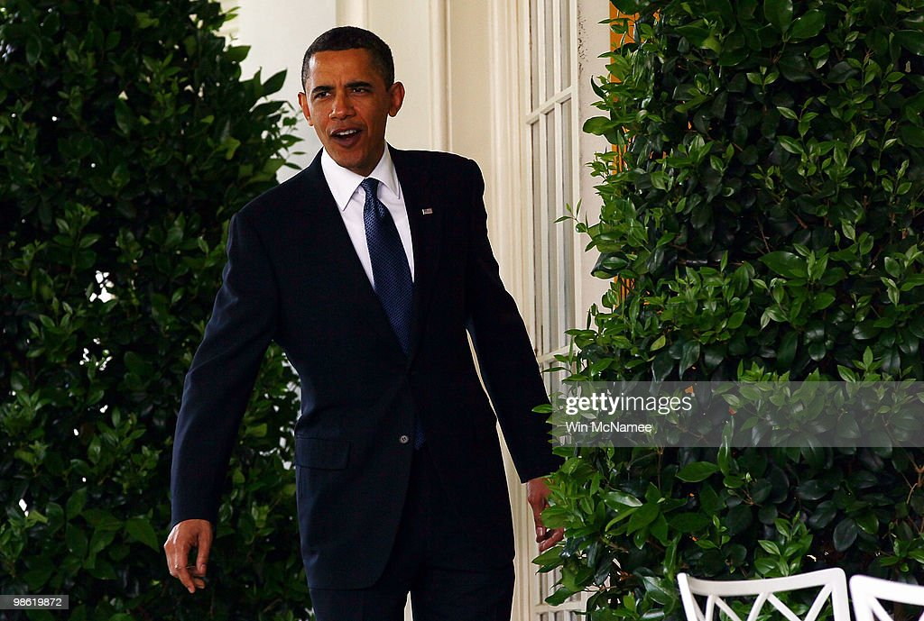 U.S. President Barack Obama walks from the Oval Office to a reception marking Earth Day in the Rose Garden of the White House April 22, 2010 in Washington, DC. Today marks the 40th anniversary of the Earth Day movement.