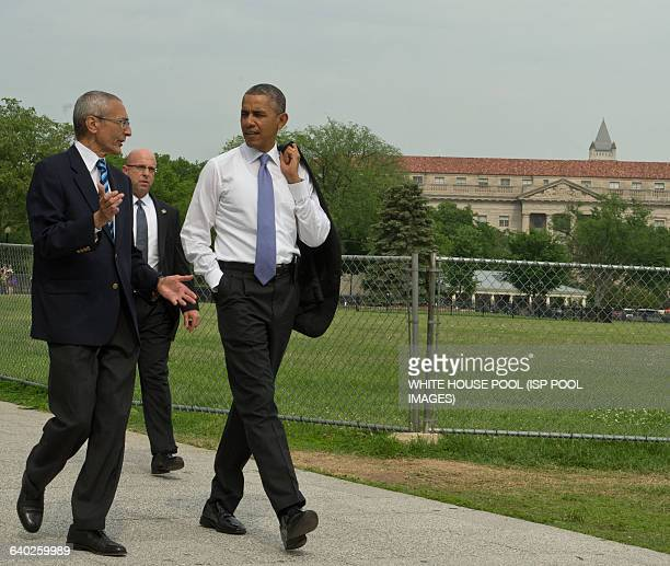 President Barack Obama walks from the White House to the United States Department of the Interior to sign an Executive Order accompanied by White...