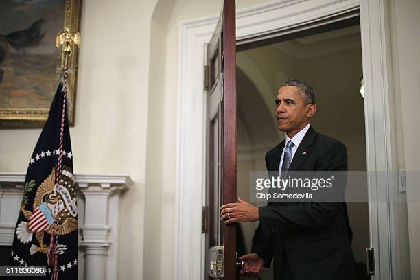President Barack Obama walks into the Roosevelt Room before making a statement about his plan to close the detention camp at the Guantanamo Bay Naval...