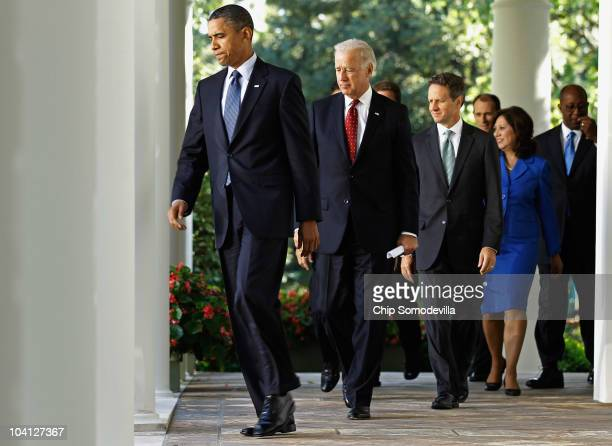 S President Barack Obama walks into the Rose Garden before urging Congress to pass a bill for middle class tax cuts along with members of his cabinet...