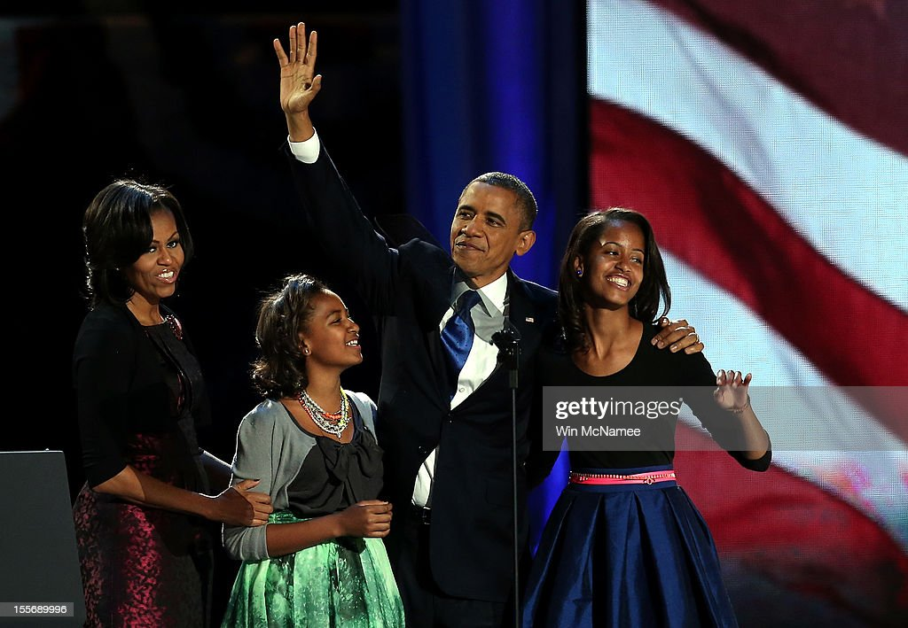 U.S. President Barack Obama walks on stage with first lady Michelle Obama and daughters Sasha and Malia to deliver his victory speech on election night at McCormick Place November 6, 2012 in Chicago, Illinois. Obama won reelection against Republican candidate, former Massachusetts Governor Mitt Romney.