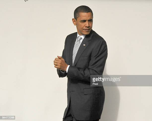 S President Barack Obama walks on the Colonnade to the Oval Office after returning to the White House from an appearance at a Home Depot December 15...