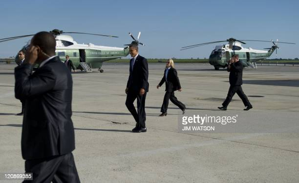 US President Barack Obama walks on the tarmac as he arrives at John F Kennedy International Airport in New York City on August 11 2011 where he will...