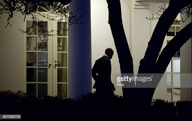 President Barack Obama walks out of the Oval Office toward the Executive Residence while departing the White House on January 28, 2016 in Washington,...