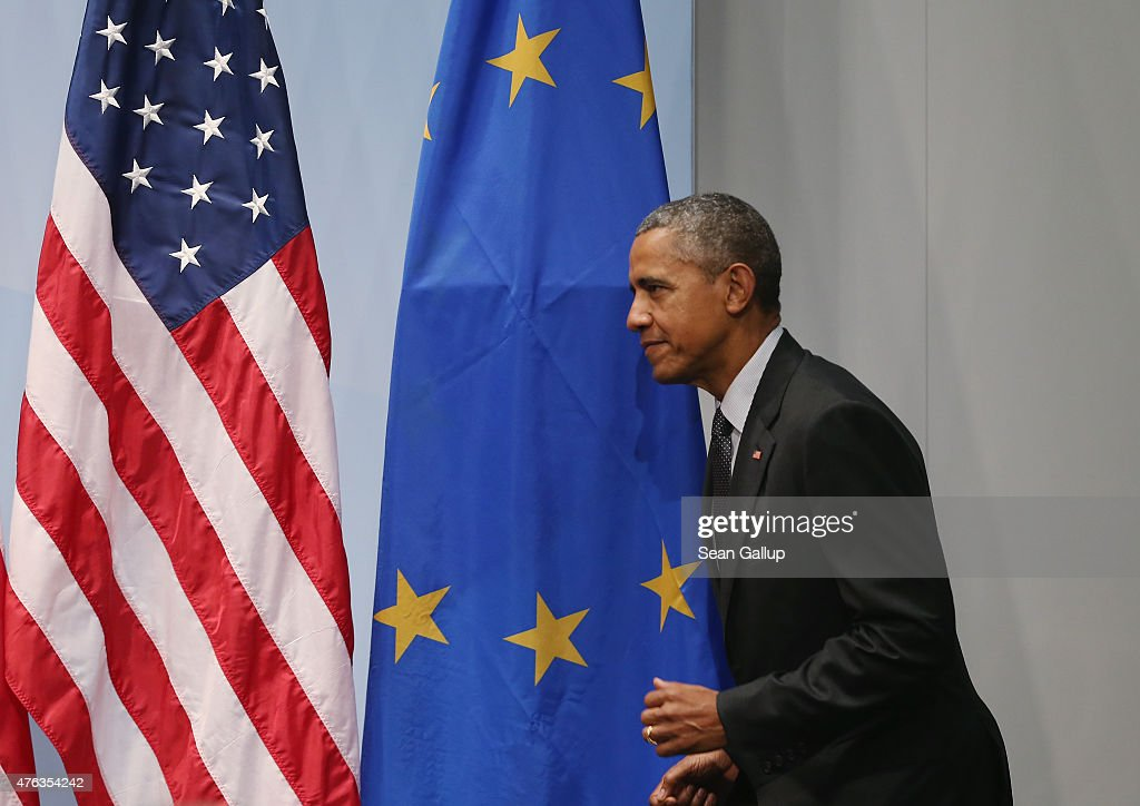 S. President Barack Obama walks past a flag of the European Union as he arrives to speak to the media at the conclusion of the summit of G7 nations at Schloss Elmau on June 8, 2015 near Garmisch-Partenkirchen, Germany. In the course of the two-day summit G7 leaders discussed global economic, health, climate and security issues.