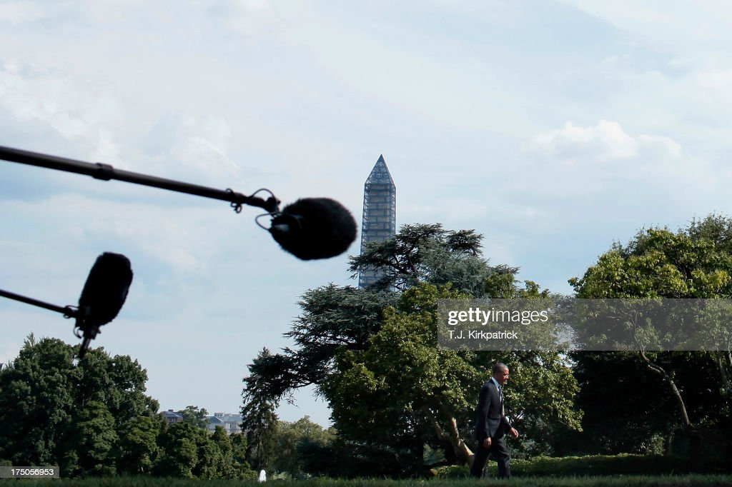 U.S. President Barack Obama walks past extended microphones as he returns to the White House after speaking at the Amazon Fulfilment Center in Tennessee, on July 30, 2013 in Washington, DC. In his speech the president attacked republican efforts at job creation, including the Keystone XL pipeline, shrinking the Environmental Protection Agency, and repeated attempts in Congress to repeal the Affordable Care Act.