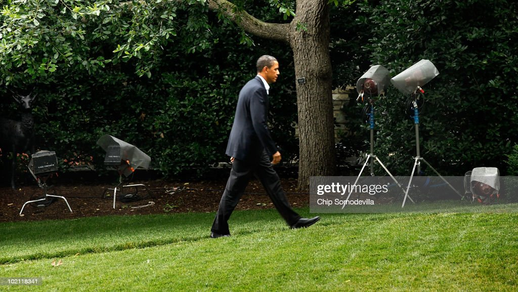 U.S. President Barack OBama walks past television lights on tripods outside the Oval Office after he returned from an overnight trip to the Gulf Coast June 15, 2010 in Washington, DC. This was Obama's fourth trip to the region affected by the BP Deepwater Horizon explosion and oil spill since the disaster started eight weeks ago. Obama will address the nation on television tonight about the spill.