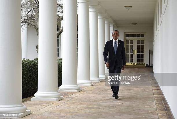 US President Barack Obama walks through the Colonnade from the Oval Office on January 12 2016 in Washington DC Obama will deliver his final State of...
