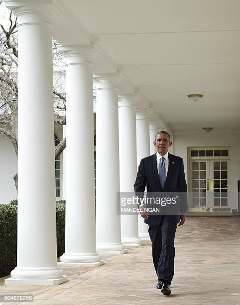 US President Barack Obama walks through the Colonnade from the Oval Office on January 12 2016 in Washington DC President Obama will deliver his final...