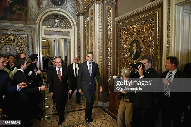 S President Barack Obama walks through the Senate Reception Room as he arrives at the US Capitol for his third day of meetings with members of...