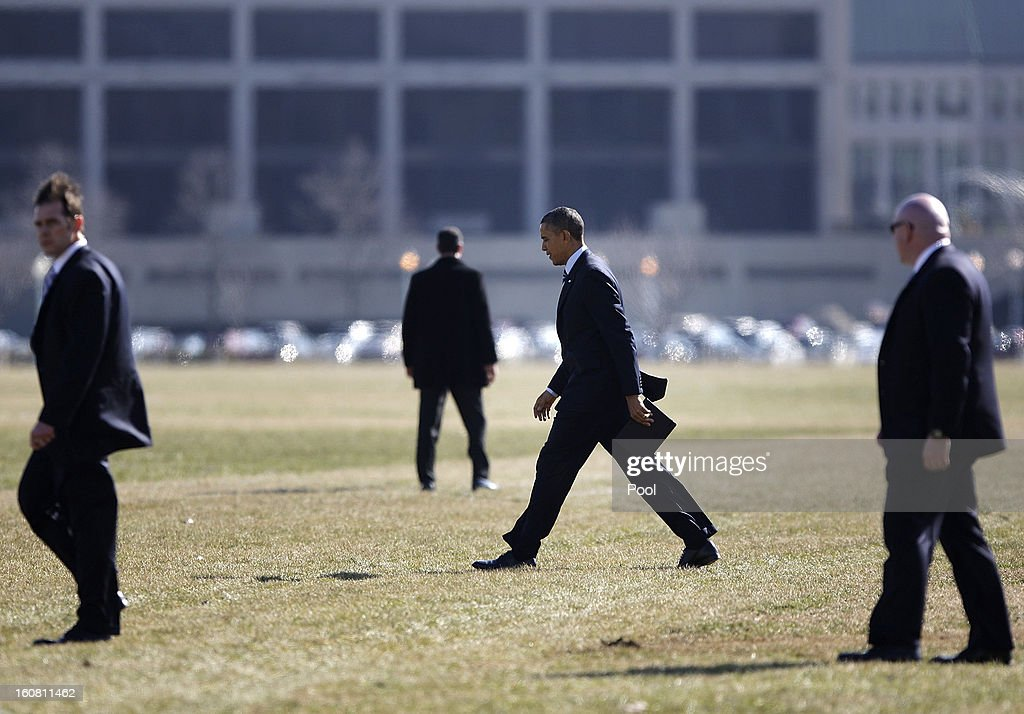 U.S. President Barack Obama (C) walks to depart via Marine One helicopter from a landing zone at the U.S. Naval Academy February 6, 2013 in Annapolis, Maryland. Obama attended the Senate Democratic Issues Conference at a nearby hotel.