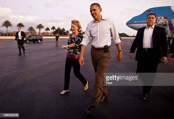 US President Barack Obama walks to greet well wishers after arriving at Joint Base Pearl HarborHickam December 23 2011 in Honolulu Hawaii President...