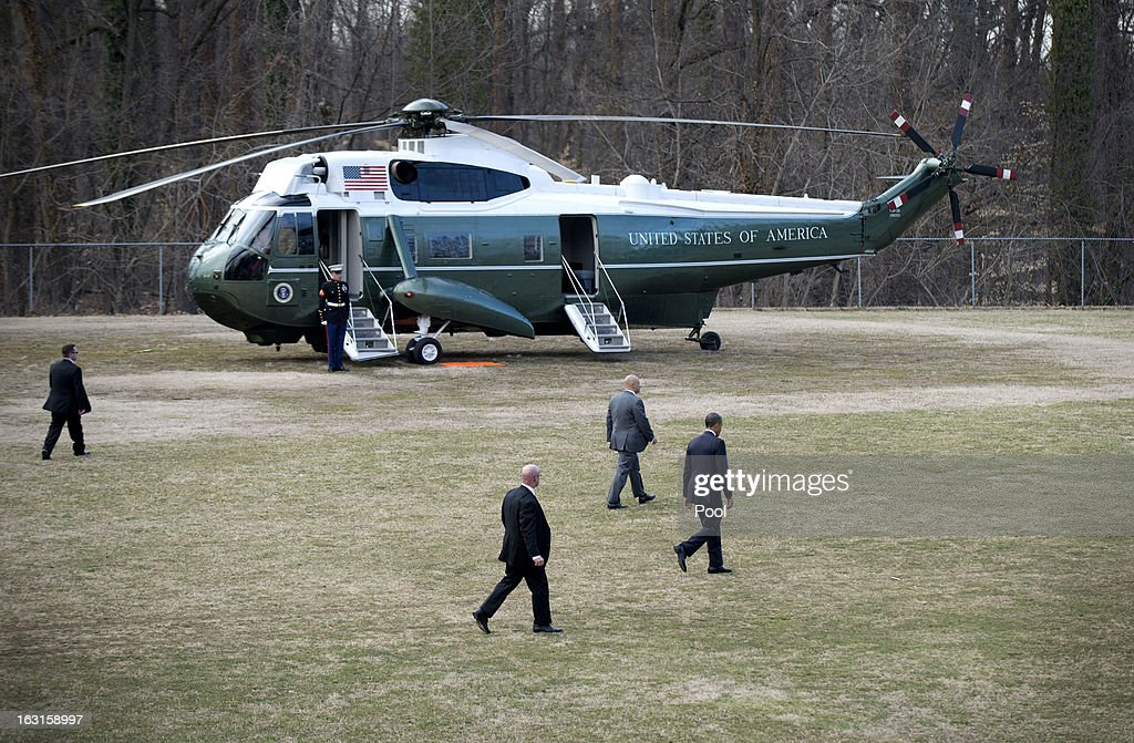U.S. President Barack Obama (R) walks to Marine One after departing Walter Reed National Military Medical Center where he visited with wounded military personnel on March 5, 2013 in Bethesda, Maryland. Later today Obama and Vice President Biden will meet with newly instated Defense Secretary Chuck Hagel in the Oval Office.