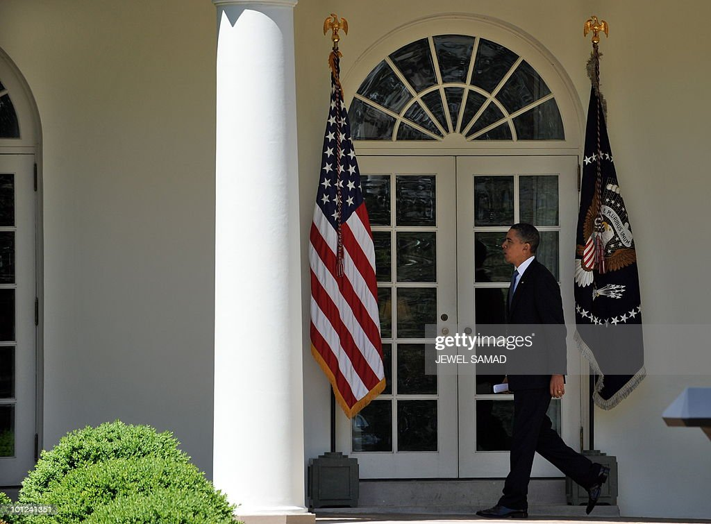 US President Barack Obama walks to Oval Office upon returning at the White House after attending the funeral of Dorothy Height, a historic figure in the US civil rights movement, in Washington, DC, on April 29, 2010. Height, who led the National Council for Negro Women for four decades, and was present at the key battles for racial equality since the 1930s, died at age 98 after a lifetime devoted to the fight for equality. AFP PHOTO/Jewel Samad