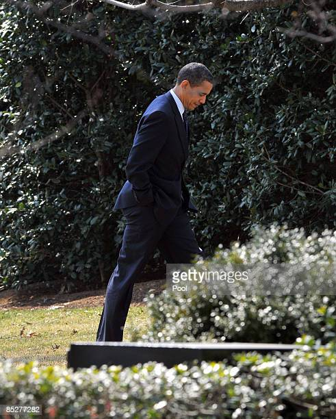 US President Barack Obama walks to the Oval Office after arriving on the South Lawn of the White House March 6 2009 in Washington DC Obama was...