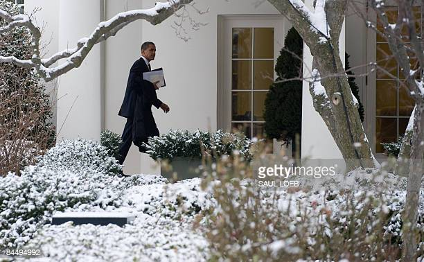 President Barack Obama walks to the Oval Office after returning to the White House from the US Capitol for meetings with House and Senate Republicans...