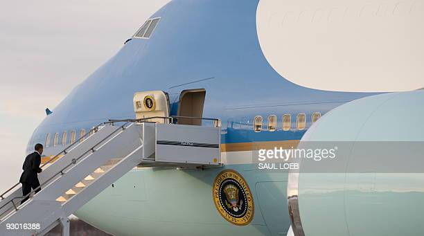 President Barack Obama walks up the stairs of Air Force One prior to departing from Elmendorf Air Force Base in Anchorage, Alaska, November 12, 2009....