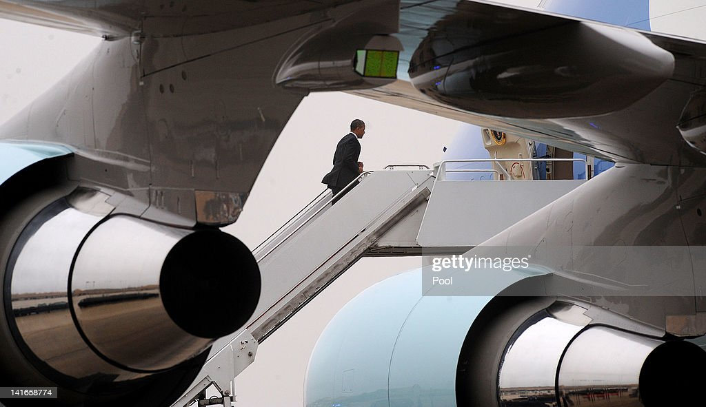 U.S. President Barack Obama walks up the steps of Air Force One on March 21, 2012 at Andrew Air Force Base, Maryland. Obama is traveling to Boulder City, Nevada to visit the largest solar power plant in the U.S.