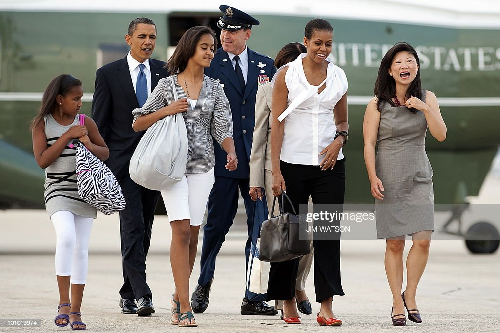 US President Barack Obama (2nd L) walks with First Lady Michell Obama (2nd R) and their children Malia (C) and Sasha (L) to Air Force One at Andrews Air Force Base, MD, May 27, 2010 as they prepare to depart for Chicago, IL. AFP PHOTO/Jim WATSON