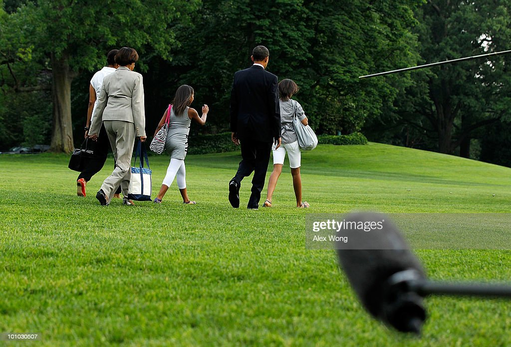 U.S. President Barack Obama (2R) walks with first lady Michelle Obama (L), daughters Malia Obama (R) and Sasha Obama (C), and the first lady's mother Marian Robinson on the South Lawn prior to their departure from the White House May 27, 2010 in Washington, DC. The Obamas were flying to Chicago for the Memorial Day weekend.