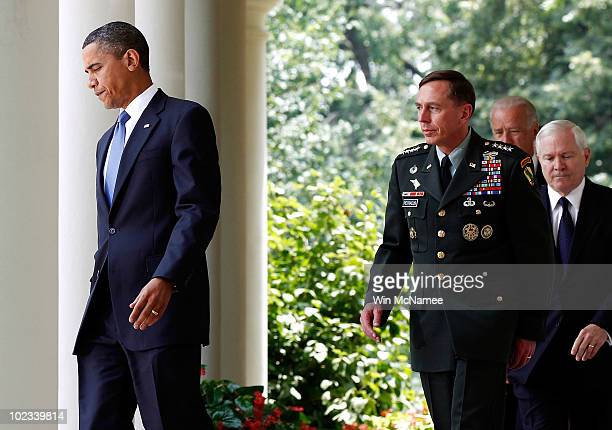 S President Barack Obama walks with Gen David Petraeus who will succeed Gen Stanley McChrystal as commander of US forces in Afghanistan Vice...