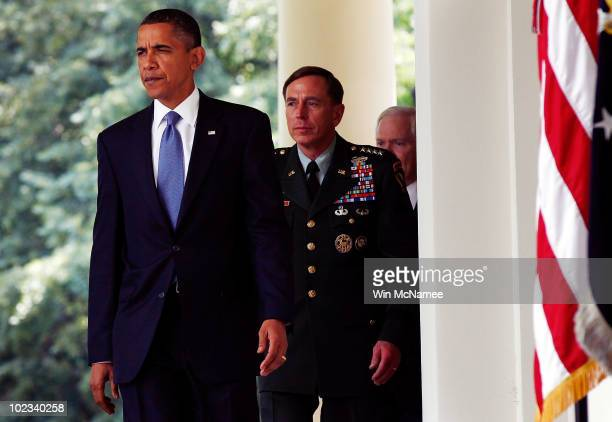 S President Barack Obama walks with Gen David Petraeus who will succeed Gen Stanley McChrystal as commander of US forces in Afghanistan and US...