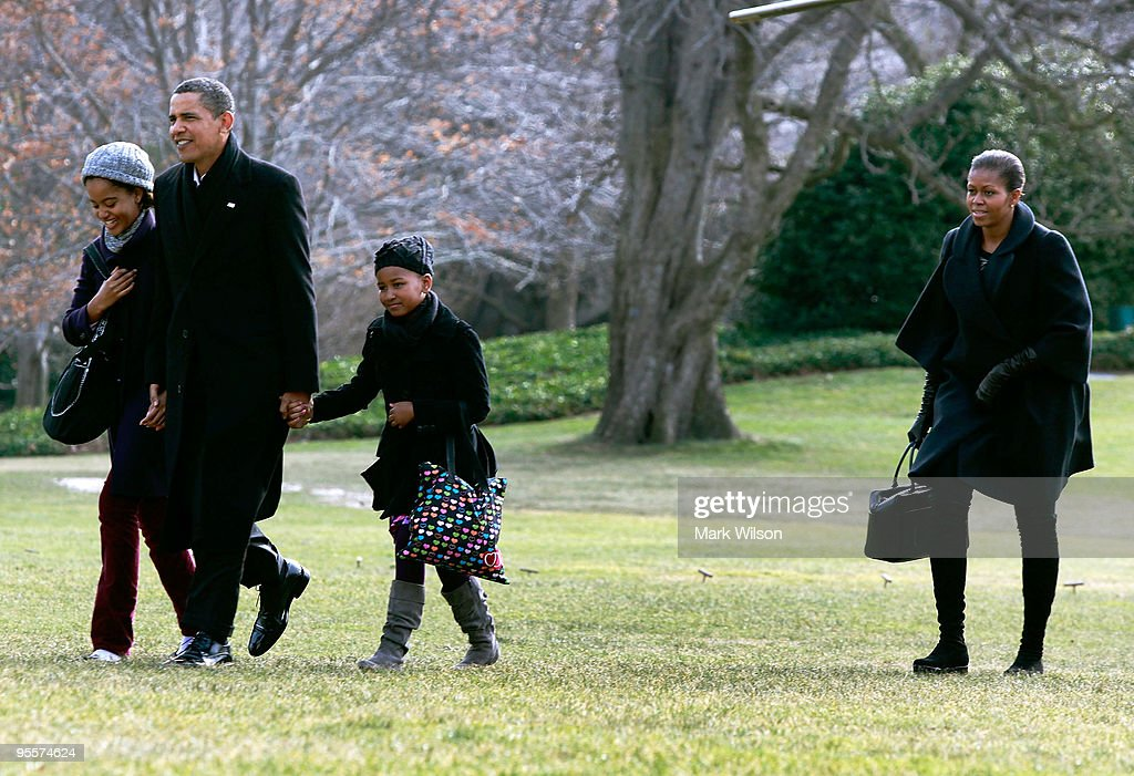 U.S. President Barack Obama (2nd-L) walks with his daughters Malia (L) and Sasha (3rd-R) and first lady Michelle Obama (R) as they arrive on the South Lawn of the White House on January 4, 2010 in Washington, DC. President Obama and his family were returning from Hawaii where they spent Christmas vacation.