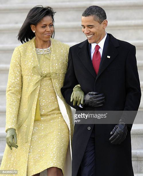 US President Barack Obama walks with his wife Michelle as they depart the US Capitol Building after Obama was sworn in as the 44th President of the...