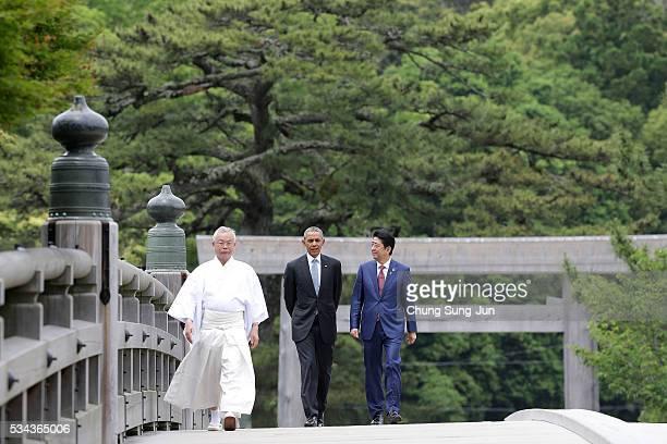 US President Barack Obama walks with Japanese Prime Minister Shinzo Abe on the Ujibashi bridge as they visit at the IseJingu Shrine on May 26 2016 in...