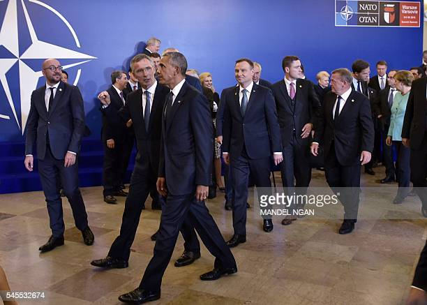 US President Barack Obama walks with NATO Secretary General Jens Stoltenberg as Belgium's Prime Minister Charles Michel looks on after posing for a...
