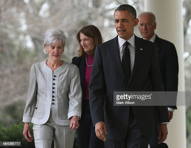 S President Barack Obama walks with outgoing Health and Human Services Secretary Kathleen Sebelius Director of the White House Office of Management...