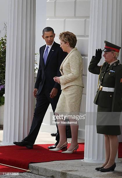 President Barack Obama walks with President of Ireland Mary McAleese at Áras an Uachtaráin on May 23 2011 in Dublin Ireland US President Obama is...