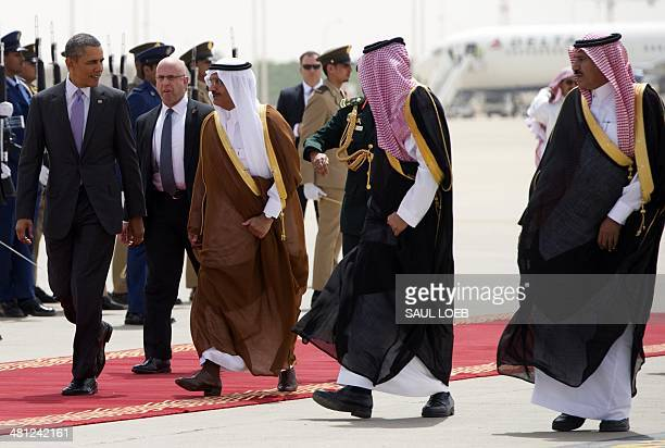 US President Barack Obama walks with Prince Khaled Bin Bandar Bin Abdul Aziz Emir of Riyadh ahead of his departure from King Khalid International...