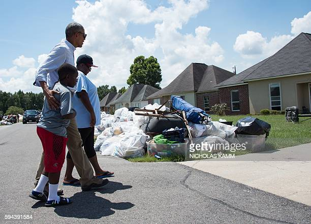 President Barack Obama walks with residents as he tours a flood-affected area in Baton Rouge, Louisiana, on August 23, 2016. Fresh from a two-week...