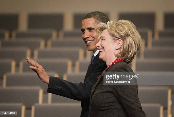 President Barack Obama walks with Secretary of State Hillary Clinton on at the Bella Centre on the final day of the UN Climate Change Conference on...