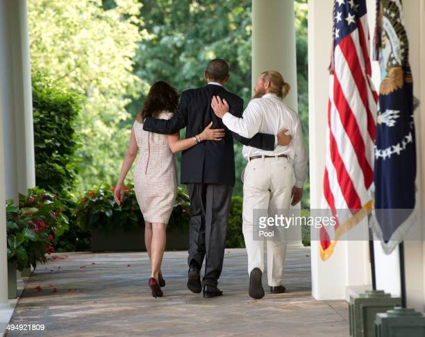 President Barack Obama walks with the parents of Sgt Bowe Bergdahl Jani Bergdahl and Bob Bergdahl back to the Oval Office after making a statement...