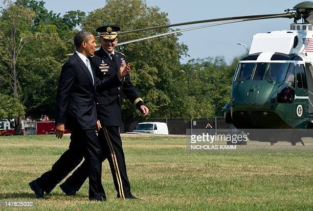 President Barack Obama walks with US Army Maj. Gen. Michael Linnington, Commanding General of the Military District of Washington, DC after stepping...