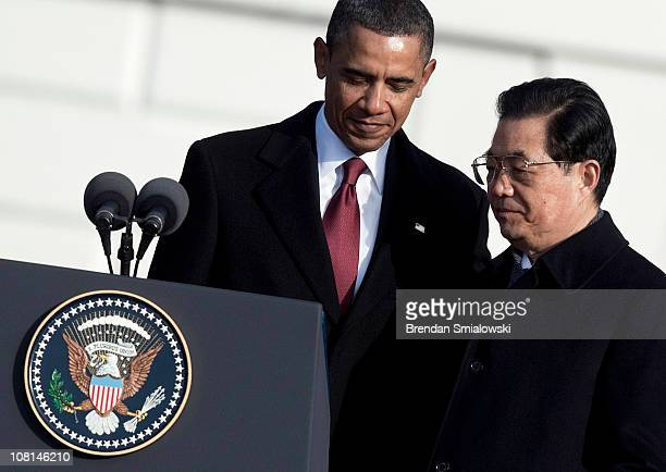 S President Barack Obama watches as Chinese President Hu Jintao walks to the podium during a state arrival ceremony on the South Lawn of the White...