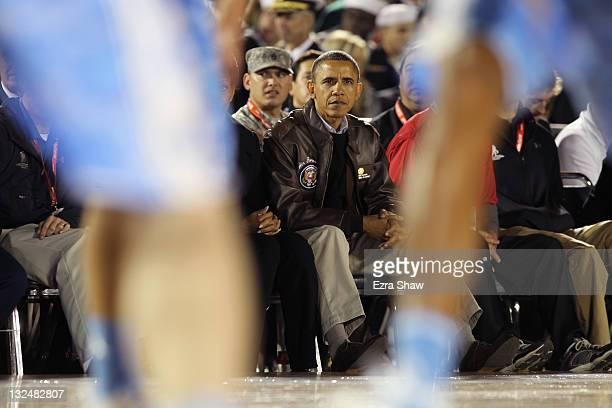 S President Barack Obama watches the NCAA men's college basketball Carrier Classic between the Michigan State Spartans and the North Carolina Tar...