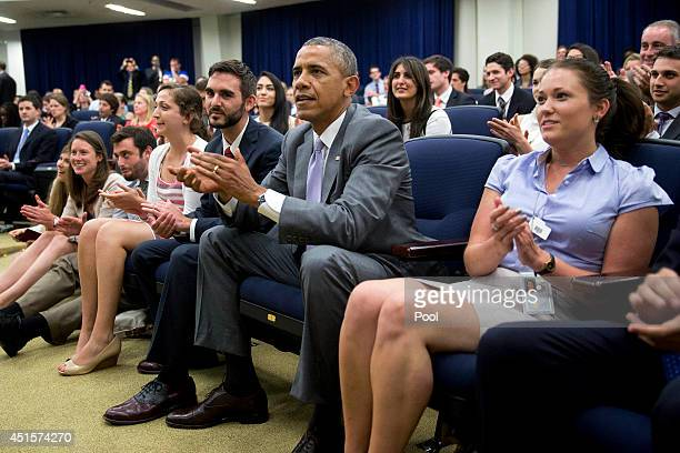 President Barack Obama watches the U.S. Play Belgium in World Cup action at the Eisenhower Executive Office Building July 1, 2014 in Washington, DC.....