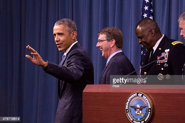 US President Barack Obama waves after delivering remarks after meeting with members of his national security team concerning ISIS at the Pentagon...