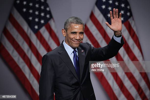 President Barack Obama waves after he spoke during the SelectUSA Investment Summit March 23, 2015 in National Harbor, Maryland. The summit brought...