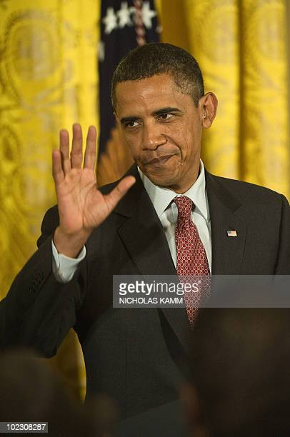 US President Barack Obama waves after speaking at a Lesbian Gay Bisexual and Transgender Pride Month event in the East Room of the White House in...